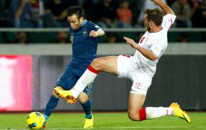 Georgia's Guram Kashia chases France's Mathieu Valbuena during their 2014 World Cup qualifying soccer match at the Boris Paichadze National Stadium in Tbilisi